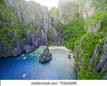 El Nido, Palawan, Philippines, aerial view of boats and karst scenery at Secret Lagoon beach.