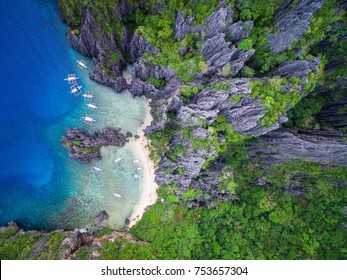 El Nido, Palawan, Philippines, aerial view of boats moored at Secret Lagoon beach.