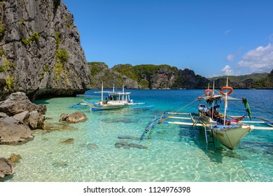 El Nido, Palawan, Philippines - December 5, 2017: Boat on the sea in El Nido - Palawan, Philippines. Transparent turquoise sea water