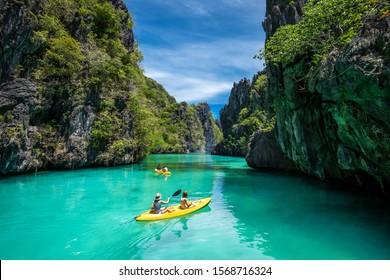 El Nido, Palawan, Philippines - May 27: Tourists on kayaks exploring the natural sights around El Nido on a sunny day in Palawan Island, Philippines.