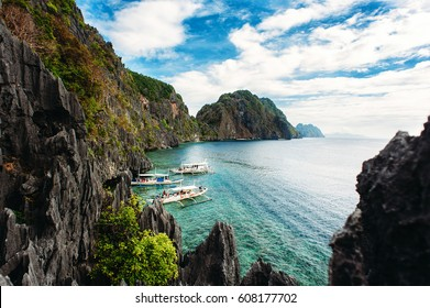 El Nido, Palawan, Philippines. Philippine boats in turquoise clean water with sharp rocks a background. Tropical country. wide angle, top view