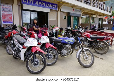 El Nido, Philippines - Apr 4, 2017. Motorbikes for rent at downtown in El Nido Town, Philippines. El Nido is known for its sand beaches, coral reefs, and as the gateway to small islands.