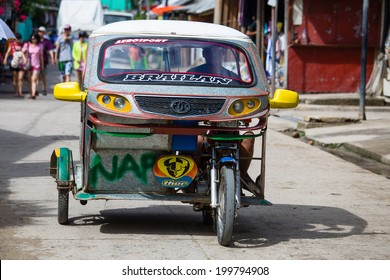 EL NIDO, PHILIPPINES - FEBRUARY 2, 2014 :Tricycle motor taxi, Philippines inexpensive transport service. Tricycle motor taxi are the most popular means of public transportation in the Philippines.