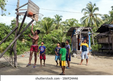 El NIDO, PHILIPPINES - JAN 11: Kids and teenagers are playing basketball in a small and poor village on January 11, 2014 in El Nido, Palawan island, Philippines