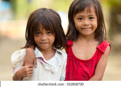 EL NIDO, PHILIPPINES, JANUARY 11,  2014 : Portrait of two Filipino little girls in a village near El Nido, Philippines.