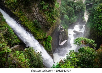 El Pailon del Diablo waterfall. The amazing stream of water and all its strenght can be perceived. In the middle of the image you can see a stair in which you can get closer tot he waterfall. Ecuador.