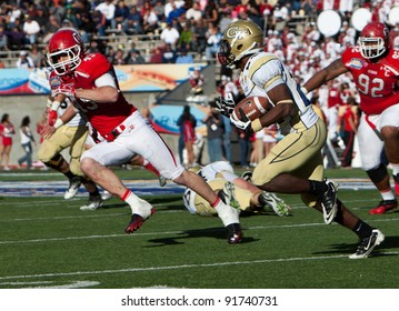 EL PASO – DECEMBER 31:  Georgia Tech's Emery Peeples (24) carries the ball during UTAH's overtime 30 to 27 win over Georgia Tech at the Sun Bowl on December 31, 2011 in El Paso, Texas.