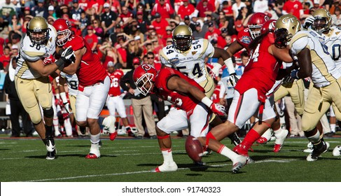 EL PASO – DECEMBER 31:  UTAH's John White IV fumbles the ball during UTAH's overtime 30 to 27 win over Georgia Tech at the Sun Bowl on December 31, 2011 in El Paso, Texas.