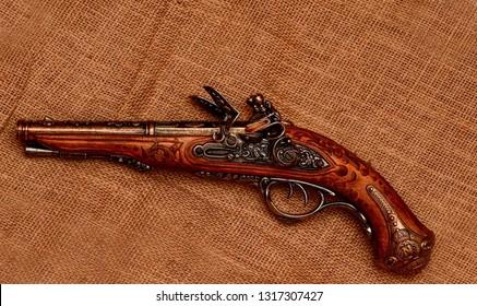El Paso, Texas - 19 February 2019: Replica model of a beautifully detailed Flintlock pistol.