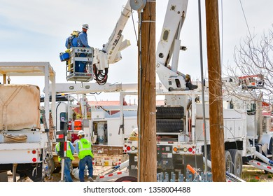 El Paso, Texas - 2 April 2019: Power company employees installing a huge, new utility pole.