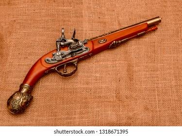 El Paso, Texas - 20 February 2019: A very fine replica of an ancient flintlock pistol.