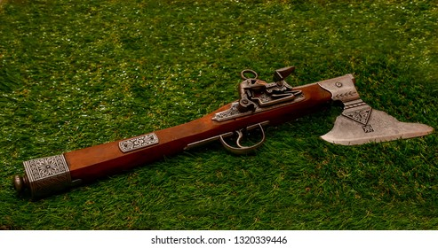 El Paso, Texas - 22 February 2019: Fascinating Flintlock pistol with ax attached.