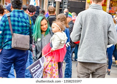 El Paso, Texas - 30 March 2019: Unidentified woman with green hair holding a cute baby attending the launch of Beto O'Rourke's presidential campaign