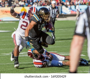 EL PASO, TEXAS - DECEMBER 31.  UCLA�a Payton (9) being tackled by Barr (11) and Adams (24) of Virginia Tech at the Sun Bowl on December 31, 2013 in El Paso, Texas.