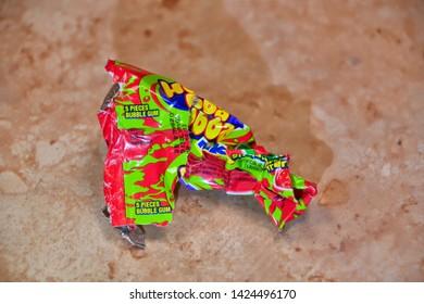 El Paso, Texas, / USA- 14 June 2019 Discarded bubble gum wrapper on ceramic tile