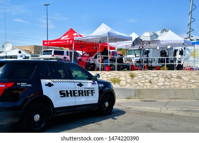 El Paso, Texas / USA - 8 August 2019  Walmart mass shooting El Paso County Sheriff patrol car parked right in front of the media. This is the area where all the flowers, candles and toys are placed.