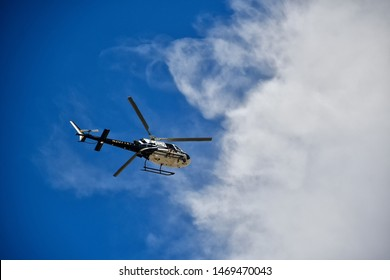 El Paso, Texas / USA - Circa August 2019 El Paso Texas Mass shooting near Cielo Vista Mall. Helicopter with a man holding an automatic weapon sitting outside the helicopter looking down