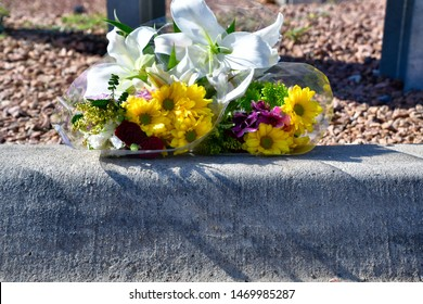 El Paso, Texas / USA - Circa August 2019 Flowers left by an unknown person for the victims of the Walmart shooting on 3 August 2019.