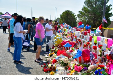 El Paso, Texas / USA - Circa August 2019  Flowers, posters, toys and other memorabilia  left by an shocked supporters of the victims of the Walmart shooting on 3 August 2019.