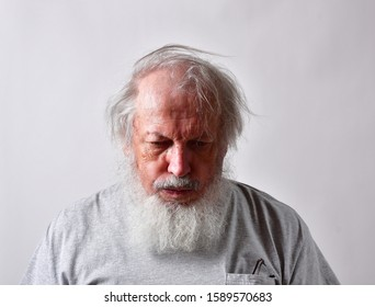 El Paso, Texas / USA: Circa December 2019 Sad picture of a disabled and elderly Caucasian male with long white beard in great mental distress. The old veteran could be thinking of suicide.