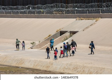 EL PASO, TEXAS, USA / CIUDAD JUAREZ, CHIHUAHUA, MEXICO - MAY 30, 2019: Migrants from Central America cross the US-Mexico border to seek asylum in the United States.