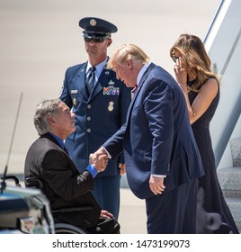 EL PASO, TX – 	AUGUST 7. President Donald Trump and Melania greet Governor Greg Abbot at the El Paso International Airport in El Paso, Texas – 7 Aug 2019