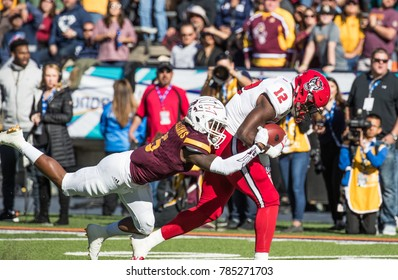 EL PASO, TX – DECEMBER 29.  Wide Receiver Stephen Louis catching a pass during the North Carolina State Wolfpack v Arizona State Sun Devils, Hyundai Sun Bowl in El Paso, Texas – 29 Dec 2017