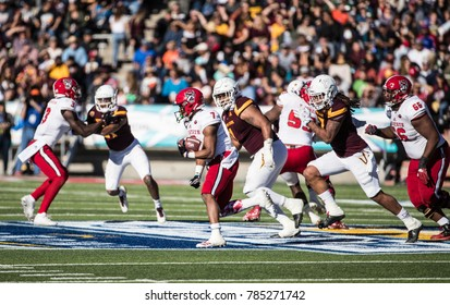 EL PASO, TX – DECEMBER 29.  Running Back Nyheim Hines (7) with the ball during the North Carolina State Wolfpack v Arizona State Sun Devils, Hyundai Sun Bowl in El Paso, Texas – 29 Dec 2017