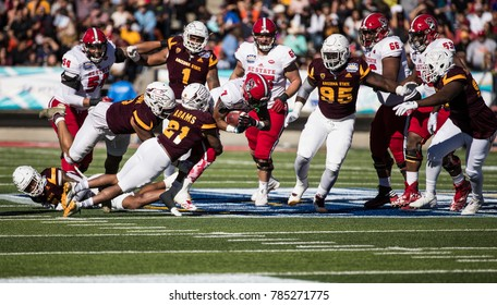 EL PASO, TX – DECEMBER 29. Nyheim Hines with the ball during the  North Carolina State Wolfpack v Arizona State Sun Devils, Hyundai Sun Bowl in El Paso, Texas – 29 Dec 2017
