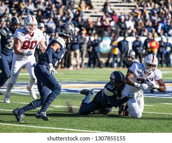 EL PASO, TX – DECEMBER 31.  Pitt's Briggs (20) tackling Sanford's Maddox during the Sanford v Pitt, Hyundai Sun Bowl in El Paso, Texas – 31 Dec 2018