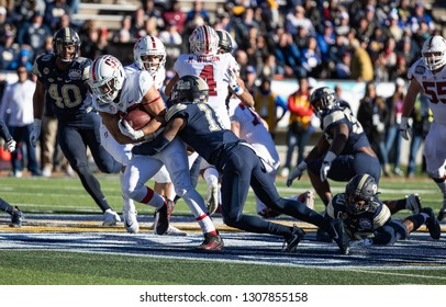 EL PASO, TX – DECEMBER 31. Sanford's Scarlett (22) being tackled by Pitt's Jackson (11) during the Sanford v Pitt, Hyundai Sun Bowl in El Paso, Texas – 31 Dec 2018