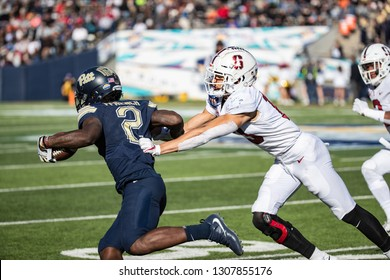 EL PASO, TX – DECEMBER 31.  Pitt's Ffrench about to be tackled by Sanford's Holder during the Sanford v Pitt, Hyundai Sun Bowl in El Paso, Texas – 31 Dec 2018
