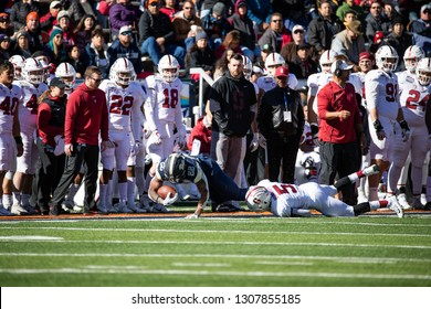 EL PASO, TX – DECEMBER 31.  Pitt's Hall (22) is tackled on the sideline by Sanford's Buncom (5) Sanford v Pitt, Hyundai Sun Bowl in El Paso, Texas – 31 Dec 2018