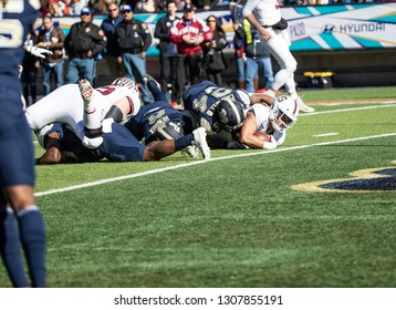 EL PASO, TX – DECEMBER 31.  Pitt stops Sanford at the one foot line during the Sanford v Pitt, Hyundai Sun Bowl in El Paso, Texas – 31 Dec 2018
