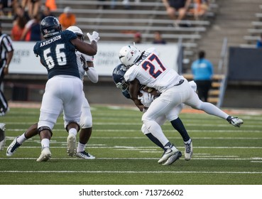 EL PASO, TX – SEPTEMBER 9.  Cockrell about to tackle opponent during the University of Texas at El Paso Miners v Rice University Owls at the Sun Bowl in El Paso, Texas – 9 September 2017