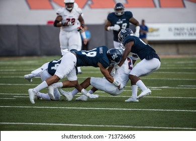 EL PASO, TX – SEPTEMBER 9.   Juniel being tackled during the University of Texas at El Paso Miners v Rice University Owls at the Sun Bowl in El Paso, Texas – 9 September 2017