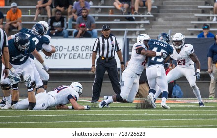 EL PASO, TX – SEPTEMBER 9.  Stewart being tackled during the University of Texas at El Paso Miners v Rice University Owls at the Sun Bowl in El Paso, Texas – 9 September 2017