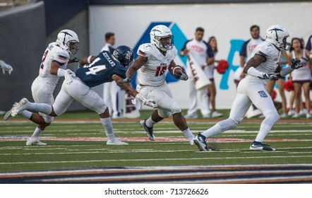 EL PASO, TX – SEPTEMBER 9.   Dove carries the ball during the University of Texas at El Paso Miners v Rice University Owls at the Sun Bowl in El Paso, Texas – 9 September 2017