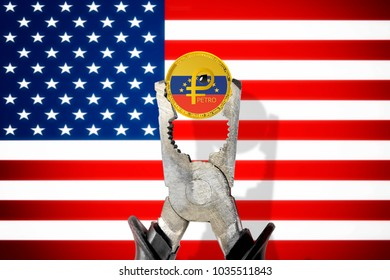 El Petro (National Venezuela cryptocurrency) coin being squeezed in vice on the United States (USA) flag background; concept of cryptocurrency PETRO (PTR) under pressure.