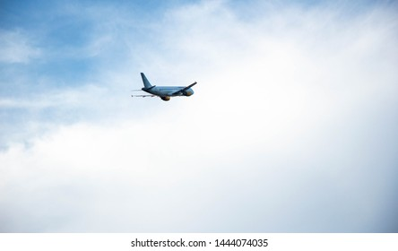 El Prat de Llobregat, Barcelona, Spain, July 4th, 2019. Vueling Airbus A320-200 taking off from Barcelona El Prat airport at sunset