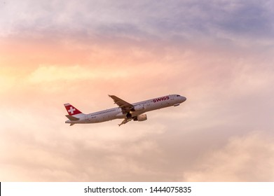 El Prat de Llobregat, Barcelona, Spain, July 4th, 2019. Swiss International Airlines Airbus A319 taking off from Barcelona El Prat airport at sunset