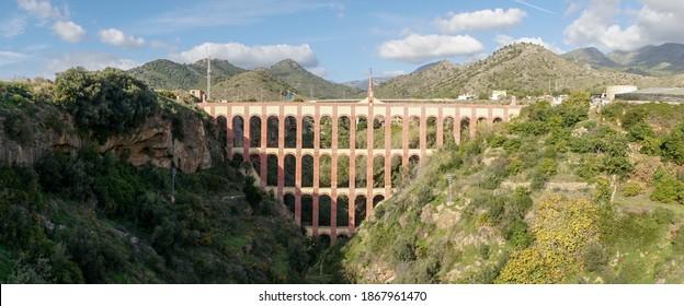 El Puente de aguila arch bridge near the ocean in Nerja, Spain.