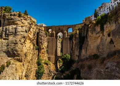"""""""El Puente Nuevo"""" (The New Bridge) in Ronda, Malaga. The old and the new town linked by a bridge on a chasm. Ronda is a beautiful town close to Malaga in Andalucia, Spain."""