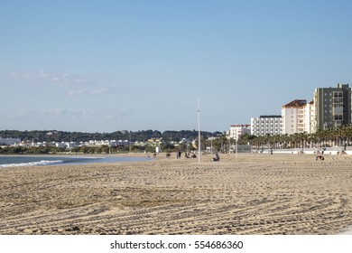 EL PUERTO DE SANTA MARIA, ANDALUSIA, SPAIN - MARCH 2016: People on the large sandy beach of the holiday resort Valdelagrana.
