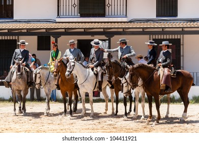 EL ROCIO, SPAIN-MAY 26: A group of horses and riders wait to join procession during the romer�a on May 26, 2012 in El Rocio.