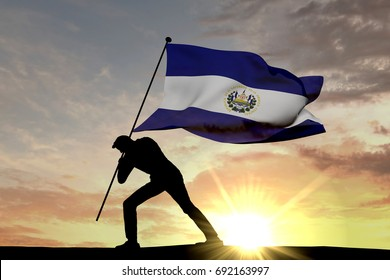 El Salavdor flag being pushed into the ground by a male silhouette. 3D Rendering