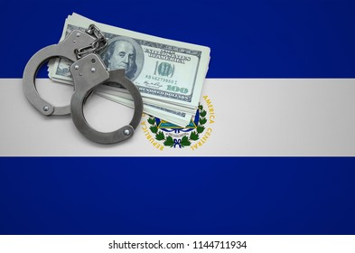 El Salvador flag  with handcuffs and a bundle of dollars. The concept of breaking the law and thieves crimes