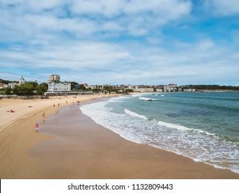 El Sardinero beach, Santander, Cantabria, Spain. People walking or bathing in the sea