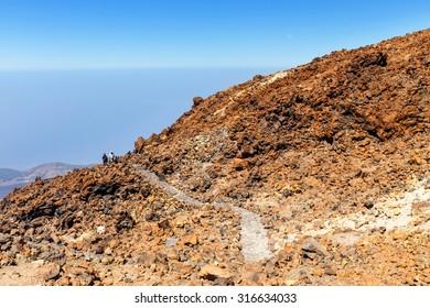 El Teide, Tenerife, June 06, 2015: Unidentified tourists are walking on the top of El Teide Volcano, Tenerife, Spain