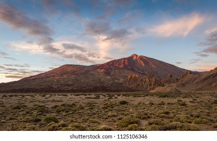 El Teide volcano at sunset light and lava desert panoramic landscape. Canarias, Spain.